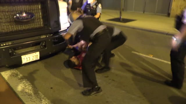 chicago, il, u.s. - police arresting protestors. hundreds of protesters marched through chicago after the death of george floyd in minneapolis. the... - arrest stock videos & royalty-free footage