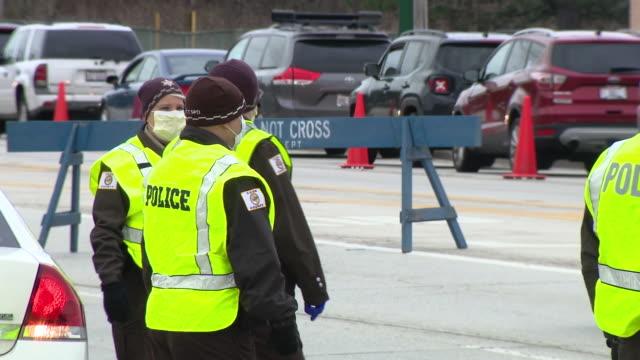 wgn chicago il us police officers protecting area of coronavirus drivethrough testing site at former vehicle emissions testing site at 6959 west... - chicago illinois stock videos & royalty-free footage