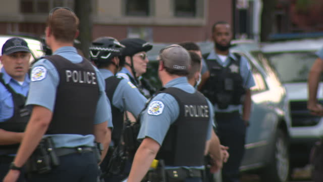 chicago, il, u.s. - police on bicycles during march organized to remember miguel vega on saturday, september 5, 2020 - uniform stock videos & royalty-free footage
