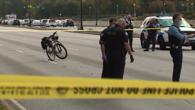 wgn chicago il us police on crime scene after shooting lake shore drive crime scene after a 19yearold woman she was shot in the head while riding in... - street name sign stock videos & royalty-free footage