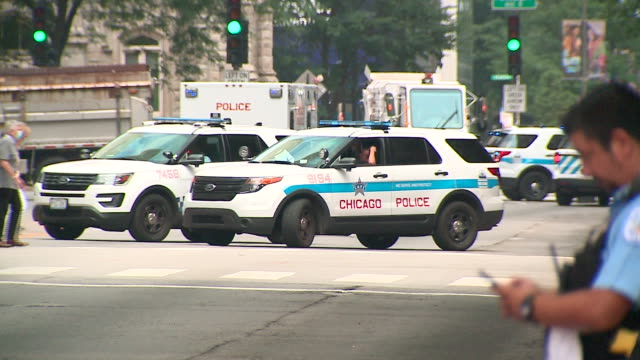 wgn chicago il us police patrols on streets morning after looting occured on monday august 10 2020 - monday morning stock videos & royalty-free footage