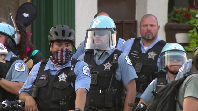 chicago, il, u.s. - police present at rally organized to remember miguel vega on saturday, september 5, 2020. - uniform stock videos & royalty-free footage