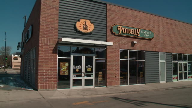 wgn chicago il us potbelly sandwich shop exteriors at 3658 n western ave with new logo on tuesday april 16 2019 - pot belly stock videos & royalty-free footage