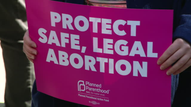 chicago, il, u.s. - pro-choice activists gathered protesting at federal plaza. event was timed to the u.s. supreme court hearing oral arguments in... - supreme court stock videos & royalty-free footage