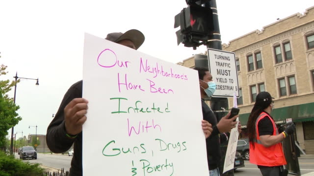 chicago, il, u.s. - protest against gun violence. a local pastor spent his birthday taking a stand against gun violence in the city. this afternoon,... - pastor stock videos & royalty-free footage