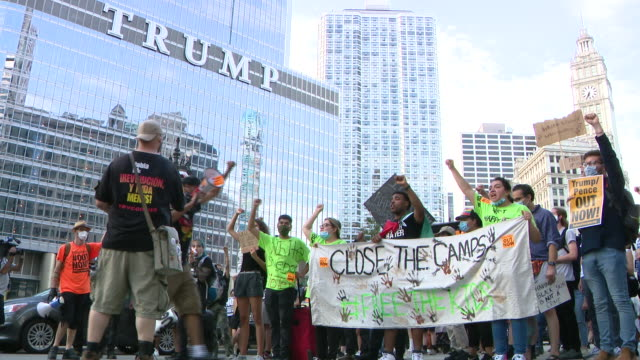 wgn chicago il us protestors giving speeches rally in chicago's millennium park followed by a march to trump tower to protest trump's presidency on... - western script stock videos & royalty-free footage