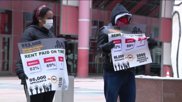 chicago, il, u.s. - protestors holding signs during rally to cancel rent and mortgage payments during covid-19 crisis outside the thompson center.... - housing difficulties stock videos & royalty-free footage