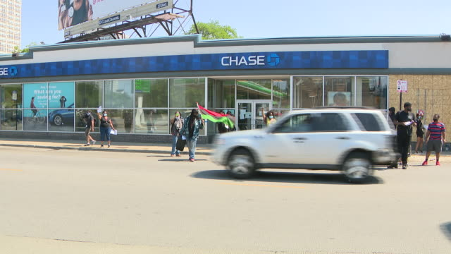 chicago, il, u.s. - protestors in front of chase bank dmand investment in black neighborhoods on tuesday, june 16, 2020. a coalition led by prominent... - home ownership stock videos & royalty-free footage