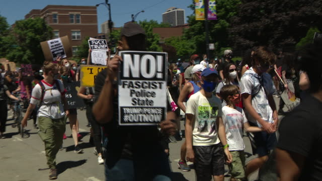 "chicago, il, u.s. - protestors with placards and american flags marching as an estimated 20 to 30 thousand people participated in ""chicago march of... - chanting stock videos & royalty-free footage"