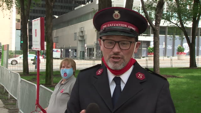 chicago, il, u.s. - salvation army member calling chicagoans to support their community on monday, september 14, 2020. - salvation army stock videos & royalty-free footage