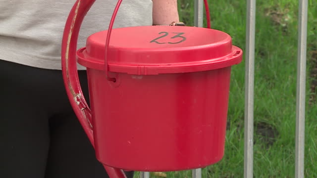 chicago, il, u.s. - salvation army's red kettle donation box at fundraiser on monday, september 14, 2020. - salvation army stock videos & royalty-free footage