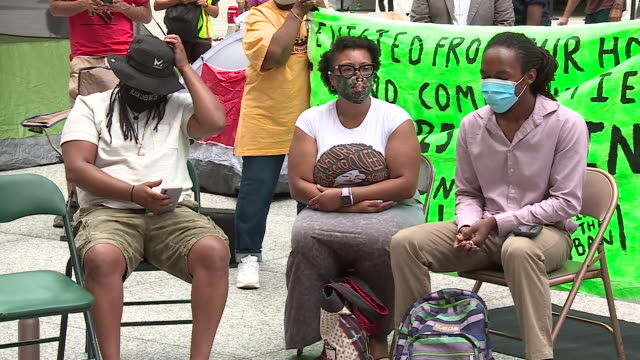 chicago, il, u.s. - shots of protestors on rally while woman speaks in spanish. activists in a coalition seeking to lift the state ban on rent... - housing difficulties stock videos & royalty-free footage