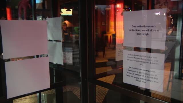 chicago, il, u.s. - signs with information of shutting down on windows of restaurants. governor jb pritzker announces shutdown of bars and... - bar drink establishment stock videos & royalty-free footage