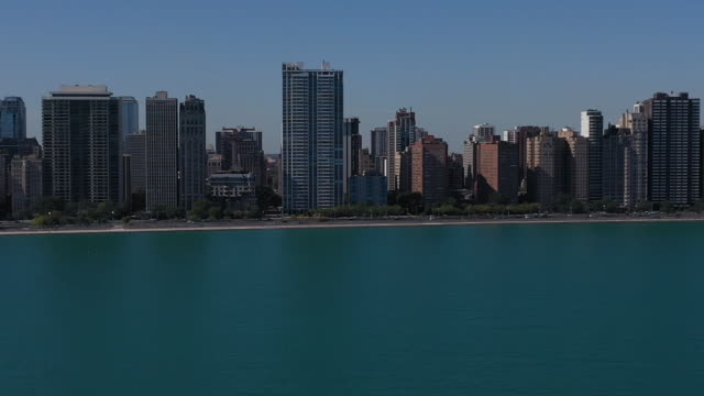 chicago, il, u.s. - skyscrapers near lake michigan with rised water level connected with climate changes on tuesday, october 8, 2019. the climate... - horizon over water stock videos & royalty-free footage