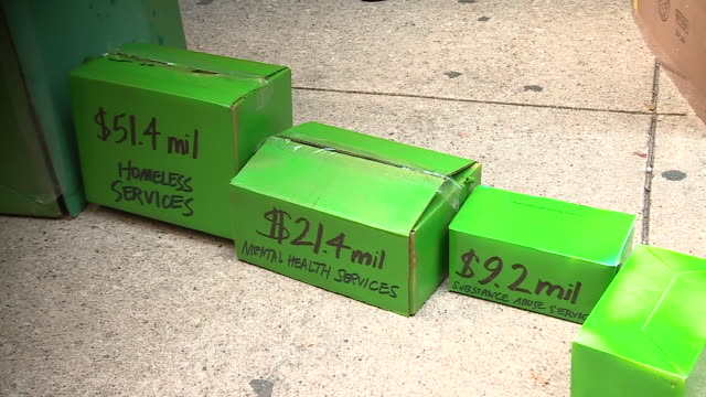 chicago, il, u.s. - stacks of green boxes symbolizing money spend on police and homeless and health services during rally for defunding the police in... - housing difficulties stock videos & royalty-free footage