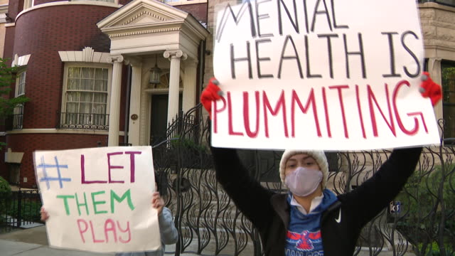 wgn chicago il us student athletes hold placards and shout outside gov pritzker's home at a rally to resume fall sports on sunday october 4 2020... - mental wellbeing stock videos & royalty-free footage