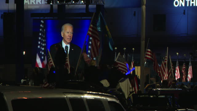chicago, il, u.s. - supporters watching joe biden's victory speech broadcasted on big screens in wilmington, delaware on saturday, november 7, 2020. - success stock videos & royalty-free footage