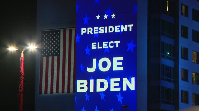 chicago, il, u.s. - supporters waving flags and celebrating during joe biden's victory speech in wilmington, delaware on saturday, november 7, 2020. - success stock videos & royalty-free footage