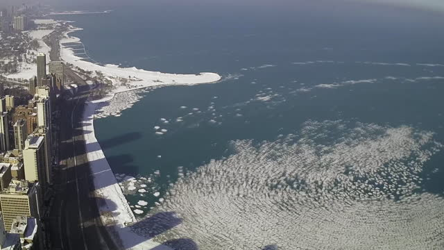 chicago, il, u.s. - time lapse of ice breaking away from lake michigan after deep freeze, on monday, february 22, 2021. - frozen stock videos & royalty-free footage
