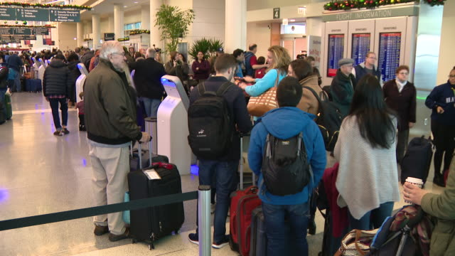 chicago, il, u.s. - travelers and flight cancellations at chicago midway international airport on christmas eve, on tuesday, december 24, 2019. - crowded airport stock videos & royalty-free footage