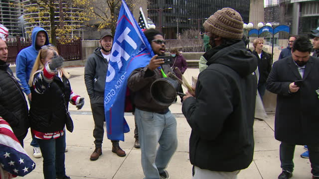 chicago, il, u.s. - trump supporters rallying amid counter-protestors on thanksgiving, thursday, november 26, 2020. - thanksgiving politics stock videos & royalty-free footage