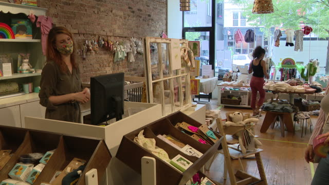 chicago, il, u.s. - women in face masks work at sprout, an organic children's clothing and accessory store amid summer sale on sunday, august 23,... - small business stock videos & royalty-free footage