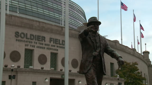 wgn chicago illinois us statue of george halas revealed outside of soldier field to honor the founder owner and head coach of chicago bears on... - male likeness stock videos & royalty-free footage