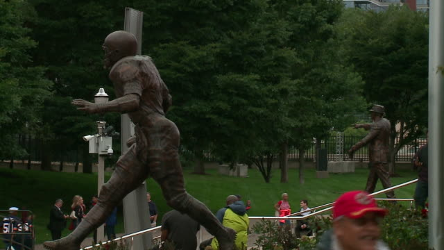 wgn chicago illinois us statues of george halas and walter payton revealed outside of soldier field to honor the players of chicago bears on tuesday... - male likeness stock videos & royalty-free footage