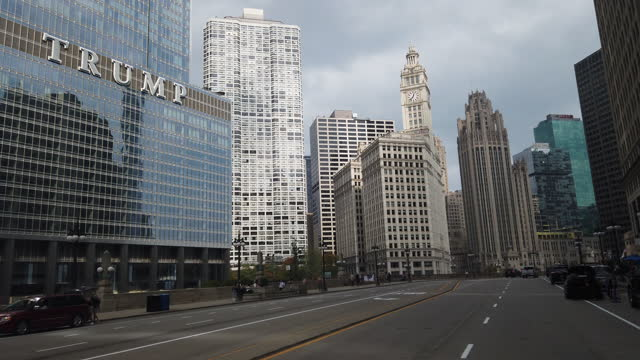 chicago, illinois, usa - october 10th, 2020: trump tower and city street. people are coming out but some streets are still empty, especially during... - distraught stock videos & royalty-free footage