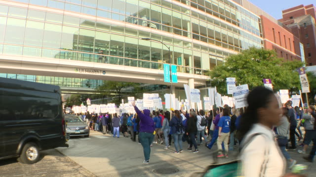 chicago, illinois,u.s. - protesting nurses shouting slogans and cheering during protest. negotiations resumed tuesday on day four of the university... - orthographic symbol stock videos & royalty-free footage