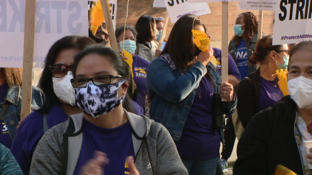 chicago, illinois,u.s. - protestors in face masks making noise on protest. negotiations resumed tuesday on day four of the university of illinois... - overworked stock videos & royalty-free footage