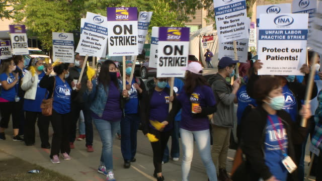 chicago, illinois,u.s. - protestors in face masks marching holding placards. negotiations resumed tuesday on day four of the university of illinois... - orthographic symbol stock videos & royalty-free footage