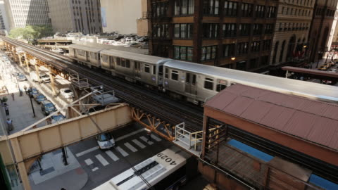 chicago l train leaving station on elevated track. view from above - chicago 'l' stock videos & royalty-free footage