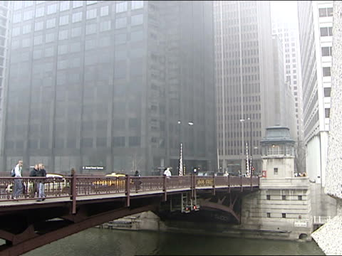 wgn chicago loop area with buildings and cars during a foggy day on march 18 2003 - chicago loop stock videos and b-roll footage