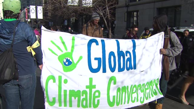 chicago members of the global climate convergence marched on earth day april 22 to protest companies blamed for contributing to environmental... - earth day stock videos & royalty-free footage