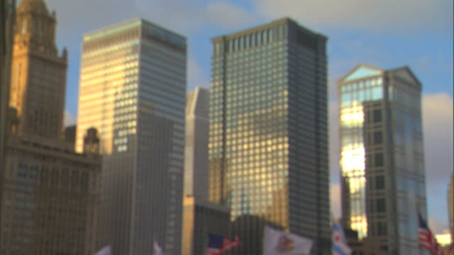 chicago metropolitan area city highrise buildings reflective glass partial flags along michigan avenue bridge lower frame chicagoland chitown windy... - michigan avenue bridge stock videos and b-roll footage