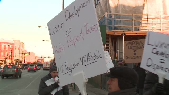 wgn chicago neighborhood logan square residents protest luxury developments in chicago on february 11 2016 - logan circle stock videos and b-roll footage