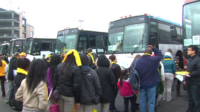 chicago parents and students rally in front of us cellular field before boarding buses to springfield in order to show support for charter schools... - boarding school stock videos & royalty-free footage
