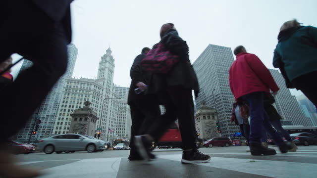 chicago pedestrians cross busy street in city traffic - chicago illinois stock videos & royalty-free footage