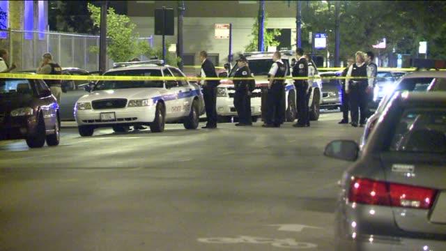 chicago police at crime scene at night on june 15 2011 in chicago illinois - 銃撃事件点の映像素材/bロール