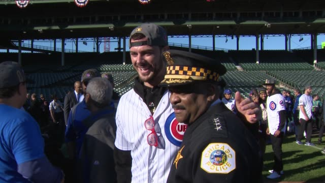 wgn chicago police chief poses with cubs player kris bryant next to mayor rahm emanuel after world series win on the morning of the victory parade on... - 警察署長点の映像素材/bロール
