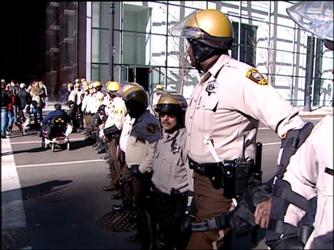chicago police in riot gear at antiwar rally on march 20 2004 in chicago illinois - 2001年~ アフガニスタン紛争点の映像素材/bロール