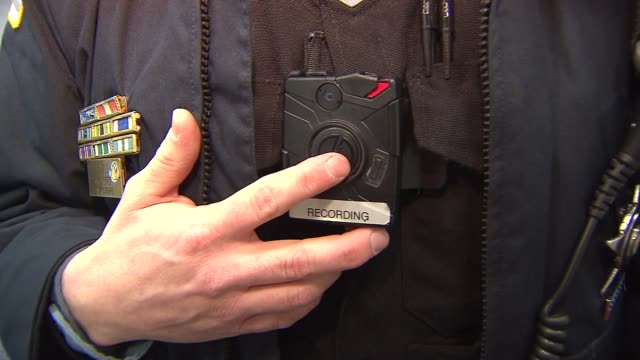 Chicago Police Officer Attaches Body Camera To Uniform and turns it on on Feb 13 2015