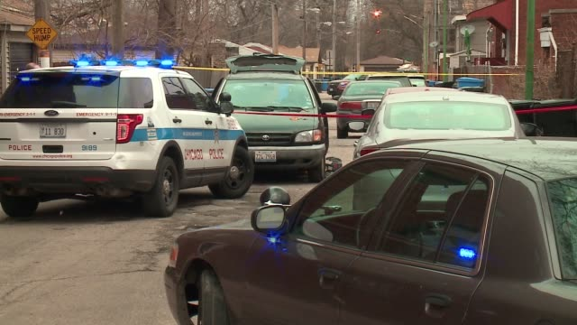 WGN Chicago police officers and vehicles at a crime scene after 38yearold Samuel Head and a 20yearold man whose name had not been released as of Feb...