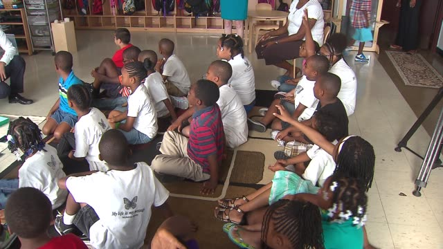 chicago public schools open for the school year elementary students raising their hands in class at luke o'toole elementary school on august 26 2013... - human limb stock videos & royalty-free footage