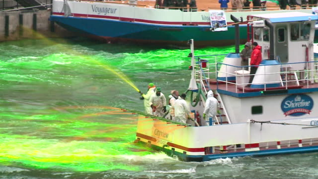 chicago river dyed green for st. patrick's day on june 17, 2018. - chicago river stock videos & royalty-free footage