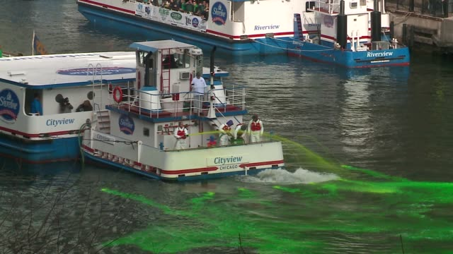 chicago river dyed green for st. patrick's day on march 12, 2016 . - chicago river stock videos & royalty-free footage