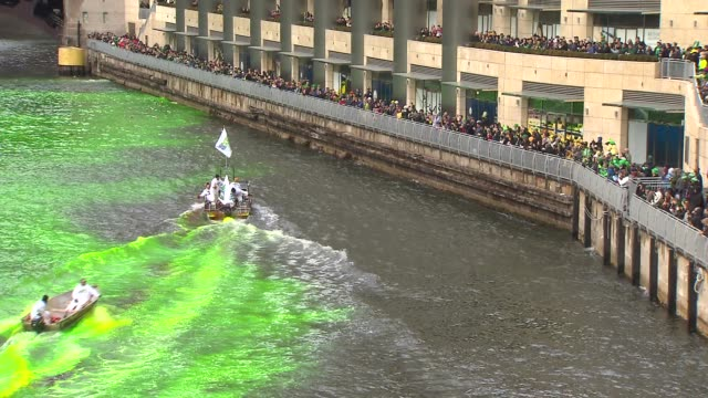 chicago river dyed green for st patrick's day on march 15 2014 in chicago illinois - river green stock videos & royalty-free footage