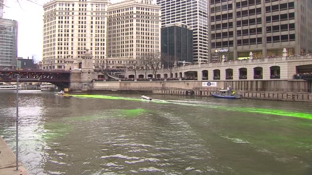 chicago river dyed green for st. patrick's day on march 17, 2013 in chicago, illinois - st. patrick's day stock videos & royalty-free footage