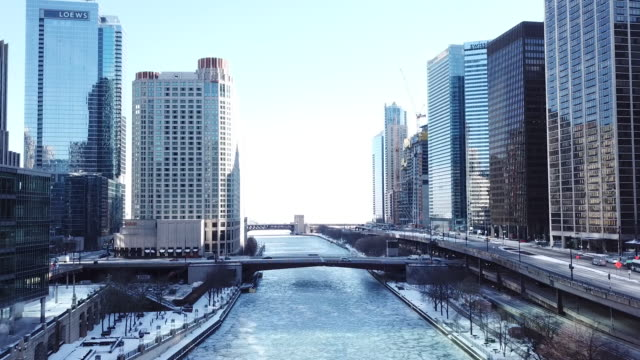 chicago river in downtown chicago from a drone point of view on jan. 2, 2018. - chicago river stock videos & royalty-free footage